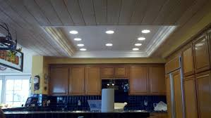 wooden ceiling with square ceiling led lighting above the kitchen