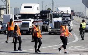 A National Disgrace': Port Truckers Demand An End To ...