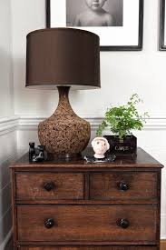 Artwork Made By The Homeowners Children Are Proudly Displayed On A Vintage Walnut Chest