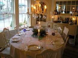 Dining Room Centerpiece Ideas Candles by Small Green Plant And White Candle On Top Oval Dining Table With