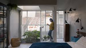 100 Kc Design KC Studio Adds Perforated Facade And Atrium To Skinny