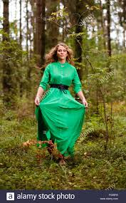 running woman in long dress at forest stock photo royalty free