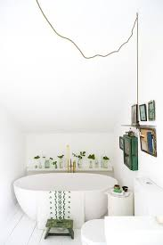 Plants In Bathroom Images by Modern White Bathroom With Pops Of Green Plants And Art