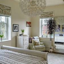Neutral Country Bedroom With Eye Catching Pendant Light