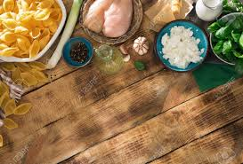Raw Ingredients For Cooking Italian Pasta On Wooden Table With Border Top View Rustic