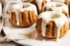 Mini pumpkin bundt cakes with spoon on a plate