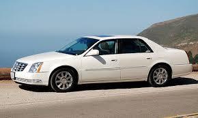 Cadillac DTS with chrome rims by coast Car