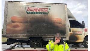 No Words': Photos Of Police Crying Over Burned Doughnut Truck Go Viral