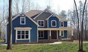 The Blue Exterior Siding With White Window Trim Stone Accents And Craftsman Style Front Porch Columns Two Story Homes