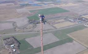 this climb a 1 500 foot tower just to change a light bulb