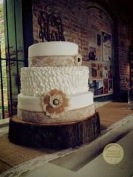 Three Tier Rustic Wedding Cake With Burlap Band And Flower At Outside Durham Venue Belt Line Station
