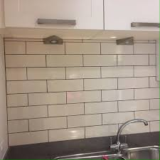 neil on a brick tile grouted with mid grey