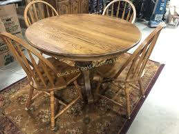 100 Oak Pedestal Table And Chairs 48 Inch Round Four Black And Gold
