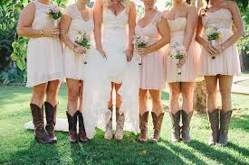 The Bride And Her Bridesmaids In Pink Cowboy Boots