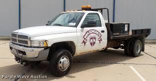 100 73 Dodge Truck 2002 Ram 3500 Flatbed Pickup Truck Item DD12 SOL