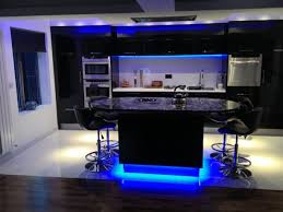 kitchen cabinets and blue light floors with modern interior