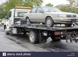 Flatbed Tow Truck Stock Photos & Flatbed Tow Truck Stock Images - Alamy