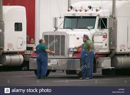 Long Haul Truck Drivers In Conversation In Front Of Trucks At Rest ... Are You Thking About A Career In Trucking Len Dubois Truck Drivers Job Titleoverviewvaultcom Truck Driving Jobs With Traing In Georgia And Sparkys Transport Hshot Equipment Hauling Gallery Long Worst Job Nascar Driving Team Hauler Sporting News 35000 Jobs For Oil Hands Oilfield Families Of America Advantages Of Becoming A Driver Davies Turner Haul From Uk To Turkey The 90 Alone On Open Road Truckers Feel Like Throway People 2015 Lht