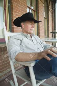 100 Cowboy In Rocking Chair A Man Wearing A Hat Sitting On A Porch A Stock