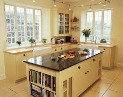 Kitchen Island Ideas For Small Kitchens by Country Broken White Galley Kitchen With Black Marble Top Storage