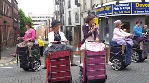 granny turismo formation dancing grannies on shopping trolleys at