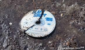 A Broken DVD Of The Hockey Movie Slap Shot Is Seen In Mud At Humboldt Broncos Crash Site
