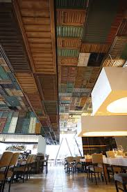 shutters used to cover a ceiling and walls pretty dramatic