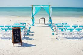 Beach Wedding Decoration Ideas With Small Tent And White Wooden Chairs Also Hanging Blue Flower Pompom Plus Blackboard Sign