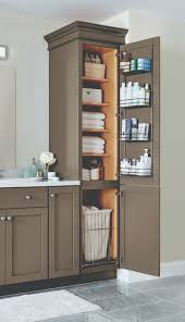 Tall Skinny Cabinet Home Depot by A Linen Closet With Four Adjustable Shelves A Chrome Door Rack