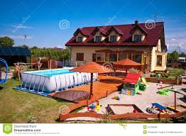 Backyard With Swimming Pool And Sandbox Stock Photo - Image: 43769848 Decorating Kids Outdoor Play Using Sandboxes For Backyard Houseography Diy Sandbox Fort Customizing A Playset For Frame It All A The Making It Lovely Ana White Modified With Built In Seat Projects Playhouse Walmartcom Amazoncom Outward Joey Canopy Toys Games Lid Benches Stately Kitsch Activity Bring Beach To Your Backyard This Fun Espresso Unique Sandboxes Backyard Toys Review Kidkraft Youtube