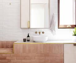 this bathroom contains a material mix of brass and acapulco