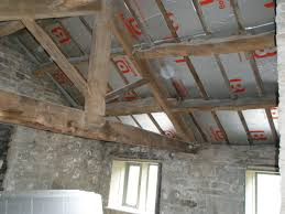 Insulating Cathedral Ceiling With Foam Board by How To Insulate Between Roof Trusses Popular Roof 2017