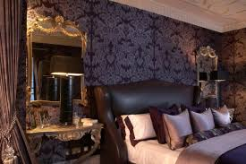 great gothic bedroom with black wallpaper and bedside ls also