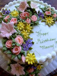 Birthday cake for Nancy with pink roses yellow and purple flower