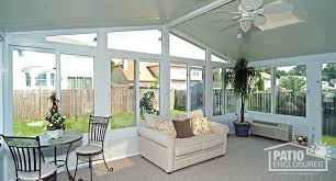 white vinyl frame four season room with gable roof and glass roof