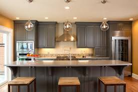 dining room shaker kitchen design with pendant light and edison