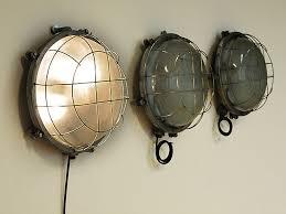 large bulkhead light with bulbs patinated metal
