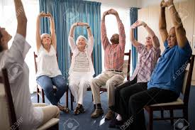 Seniors Stretching With Female Doctor While Sitting On Chairs ... Lovely High Chairs For Elderly Premiumcelikcom Choosing A Chair My Relative In Ireland Seating Comfort For The Riser Recliner Seat York With Resin Wicker Blue Office Black And Gold Raised Toilet Seats Walgreens Orthopedic 21 Seat Height The Or Hire Eaging Portable Lift T Baby Bathroom Folding Disabled Vanity Africa Looking Fniture Deluce Simple Easy To Use Cjunction With Table Aged Older Comfortable Chair High Back Seniors Idfdesign