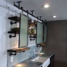 vintage industrial with plumbing pipes and wood integrated with