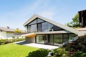 Pitched Roof House Designs Photo slope roof house with futuristic interiors
