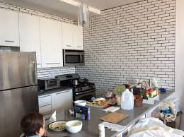 what s wrong with the crackled brick subway tile in kitchen