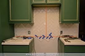 Beveled Tile Inside Corners by How To Install A Herringbone Subway Tile Backsplash