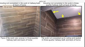inspection report showing uneven tile and gaps in grout yelp