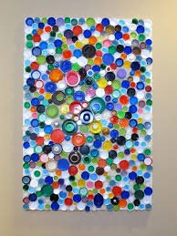 Heres An Idea For Upcycled Plastic Bottle Cap Wall Art From BluKatKraft I May Have To Give This A Go Tons Of Caps