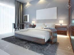 große luxus schlafzimmer im modernen stil weiß braun und grau farben ein großes bett mit einem beistelltisch und einem schminktisch mit einem