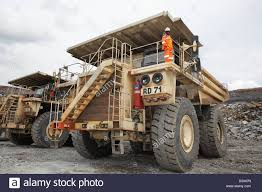 Driver Standing On Top Of His Hitachi Mine Truck Stock Photo ... Scania Wins Over Australian Mingdrivers Group Tipper Truck Chinese Ming Dump Trucks Used For Mine Work China Sinotruk Howomekingtippertruckzz5707s3840aj Trucks A Standard Truck 830e With The Ahs Retrofit Kit Running In Scales Industry Quality Unlimited Reducing Water Usage Reducing Costs Opinion Eco Open Pit Stock Video Footage Videoblocks 789d Altorfer Dramis X10 Ming Industry Bigtruck Magazine Driver Standing On Top Of His Hitachi Mine Photo Bell Brings Kamaz To Southern Africa News Komatsu Taps Head Engineer Funcannon As New Vp