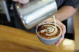 Barista Pouring Milk To Make Coffee Cappuccino Art