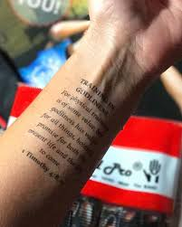 An Arm Scripture Tattoo