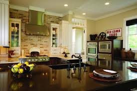 kitchen faucet with brick wall decor and recessed
