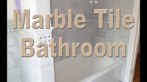 complete installation large format marble and slate bathroom time